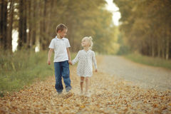 brother-sister-country-road-autumn-63872274