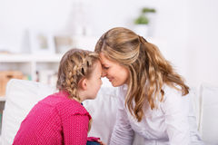 mother-daughter-close-together-holding-heads-house-43966914